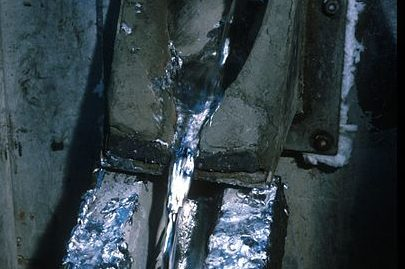 metal being pulled from casting machine