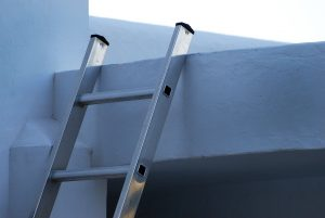 Aluminum ladder leaning on a wall