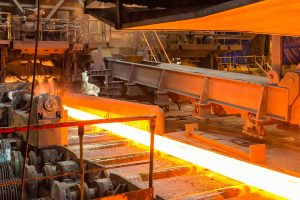Factory showing hot molten metal ready for rolling