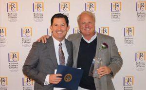 Monroe CEO Garrett Morelock and John Fox after winning Rochester Hills Business of the Year 2019 award.